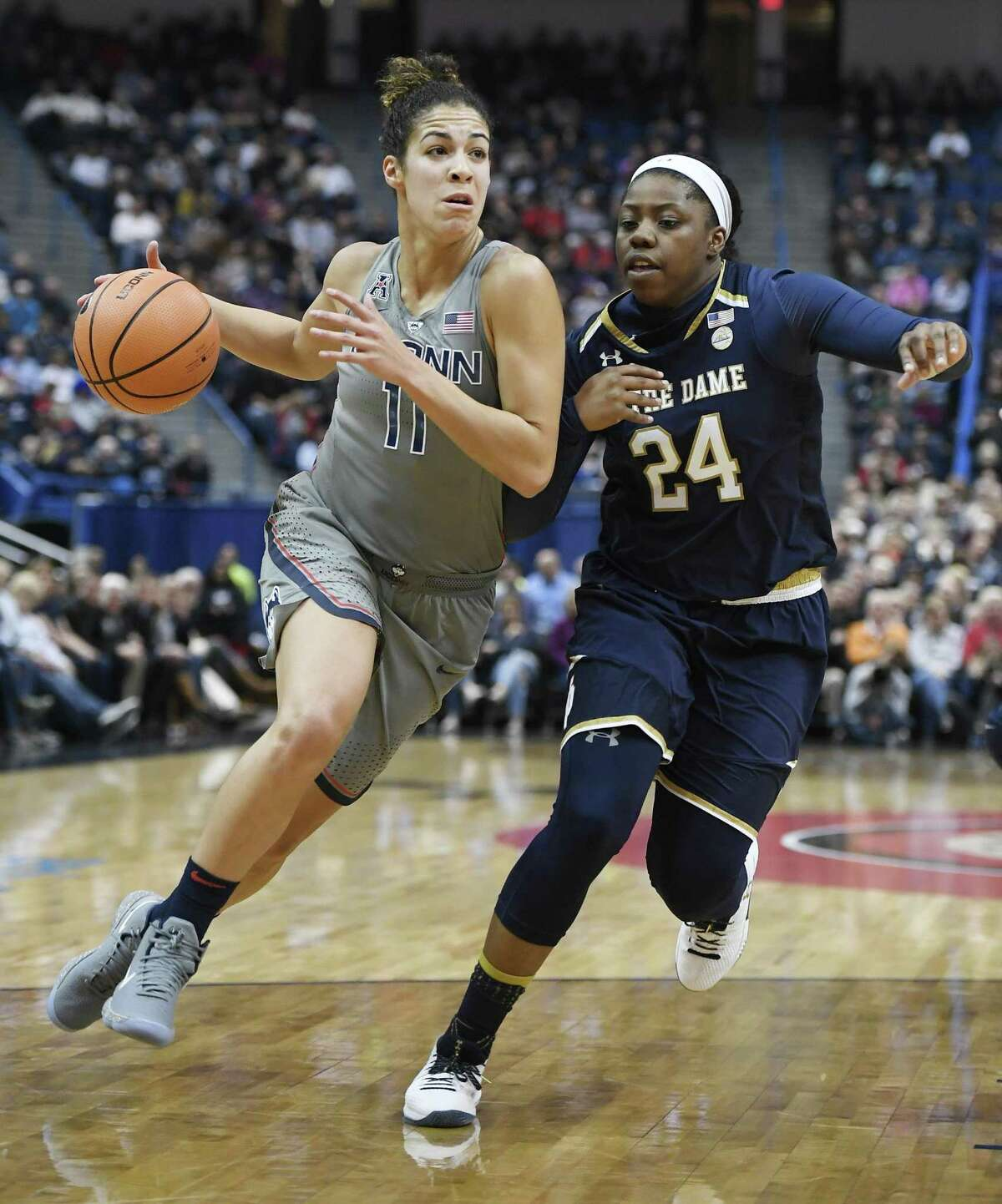 UConn's Kia Nurse dribbles as Notre Dame's Arike Ogunbowale defends during the first half Sunday in Hartford.