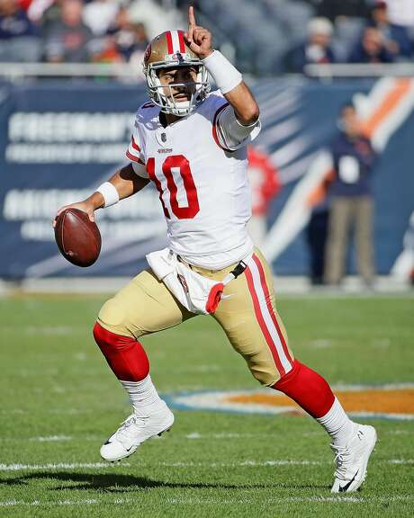 CHICAGO, IL - DECEMBER 03:   Jimmy Garoppolo #10 of the San Francisco 49ers rolls out and instructs a receiver agains the Chicago Bears at Soldier Field on December 3, 2017 in Chicago, Illinois. (Photo by Jonathan Daniel/Getty Images) Photo: Jonathan Daniel, Getty Images