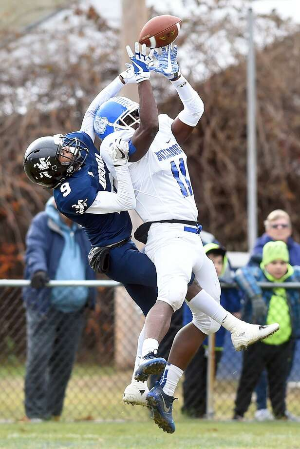 Ansonia's Tre Beall, left, breaks up a pass intended for Jalen Irving of Stafford/East Windsor/Somers in the end zone on Sunday. Photo: Arnold Gold / Hearst Connecticut Media / New Haven Register