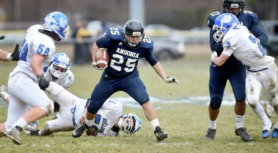 Ansonia's Darwin Amaya runs against Stafford/East Windsor/Somers in the second quarter Sunday. Photo: Arnold Gold / Hearst Connecticut Media / New Haven Register