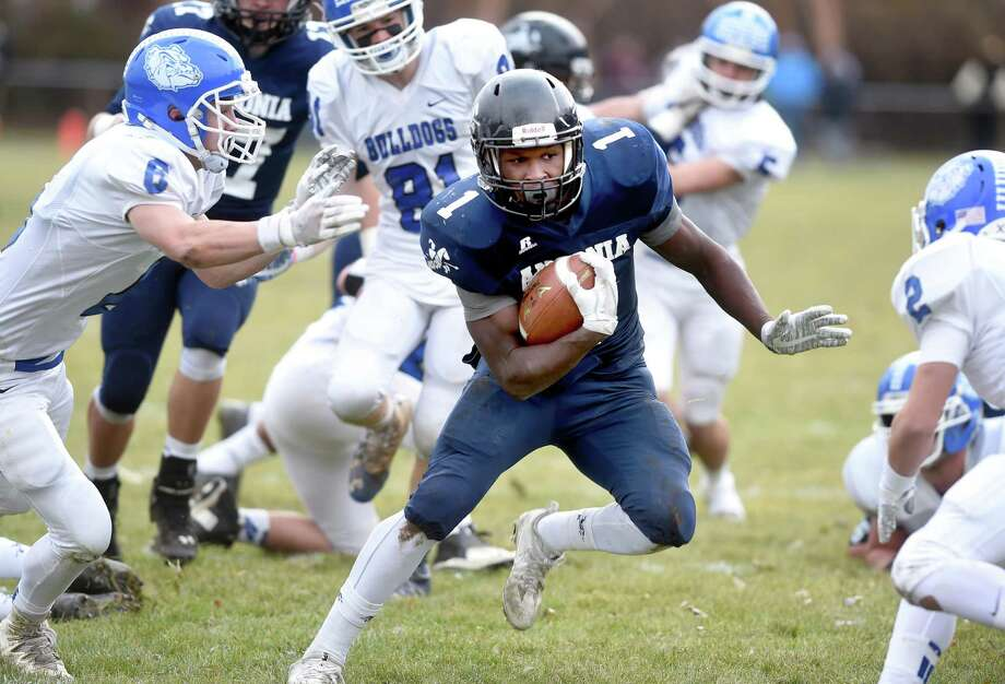 Ansonia's Markell Dobbs runs for a touchdown against Stafford/East Windsor/Somers early in the first quarter of the Class S semifinal on Sunday. Photo: Arnold Gold / Hearst Connecticut Media / New Haven Register