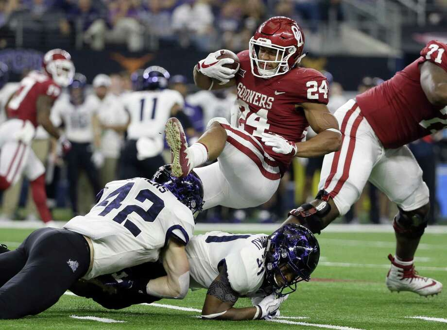 TCU linebacker Ty Summers (42) and safety Ridwan Issahaku (31) combine to stop Oklahoma running back Rodney Anderson (24) after a short run in the second half of the Big 12 Conference championship NCAA college football game, Saturday, Dec. 2, 2017, in Arlington, Texas. (AP Photo/Tony Gutierrez) Photo: Tony Gutierrez, STF / Associated Press / Copyright 2017 The Associated Press. All rights reserved.