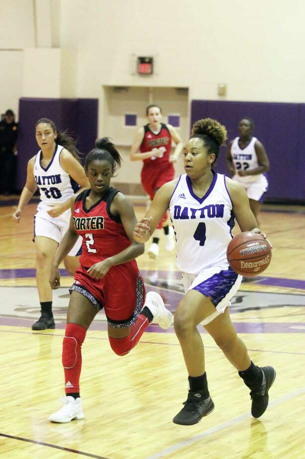 Lady Broncos Tayelin Grays schools Porters senior Keayre King as she drives to the basket for a 2-point score. Dayton dropped their home-opener, 47-35. Photo: David Taylor