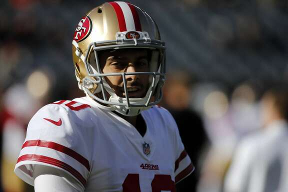 San Francisco 49ers quarterback Jimmy Garoppolo (10) warms up before an NFL football game against the Chicago Bears, Sunday, Dec. 3, 2017, in Chicago. (AP Photo/Charles Rex Arbogast)