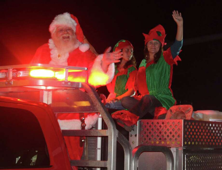 Santa Claus and his elves wave to the crowd during the Shepherd Blue and White Christmas Parade held on Dec. 2. Photo: Jacob McAdams