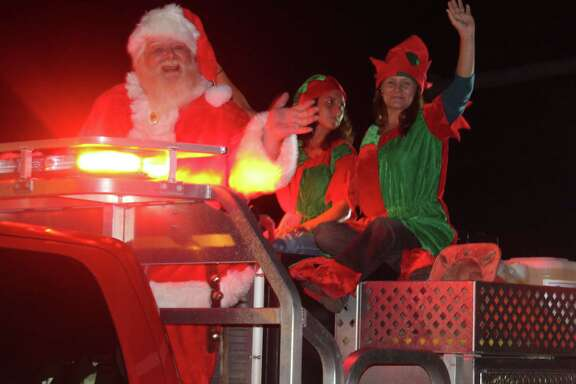 Santa Claus and his elves wave to the crowd during the Shepherd Blue and White Christmas Parade held on Dec. 2.