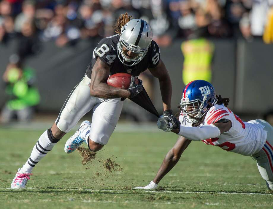 Raiders wide receiver Cordarrelle Patterson (84) gets away from Giants cornerback Brandon Dixon on Sunday in Oakland. Eight Raiders caught passes in the win, totaling 287 yards. Photo: Hector Amezcua, TNS