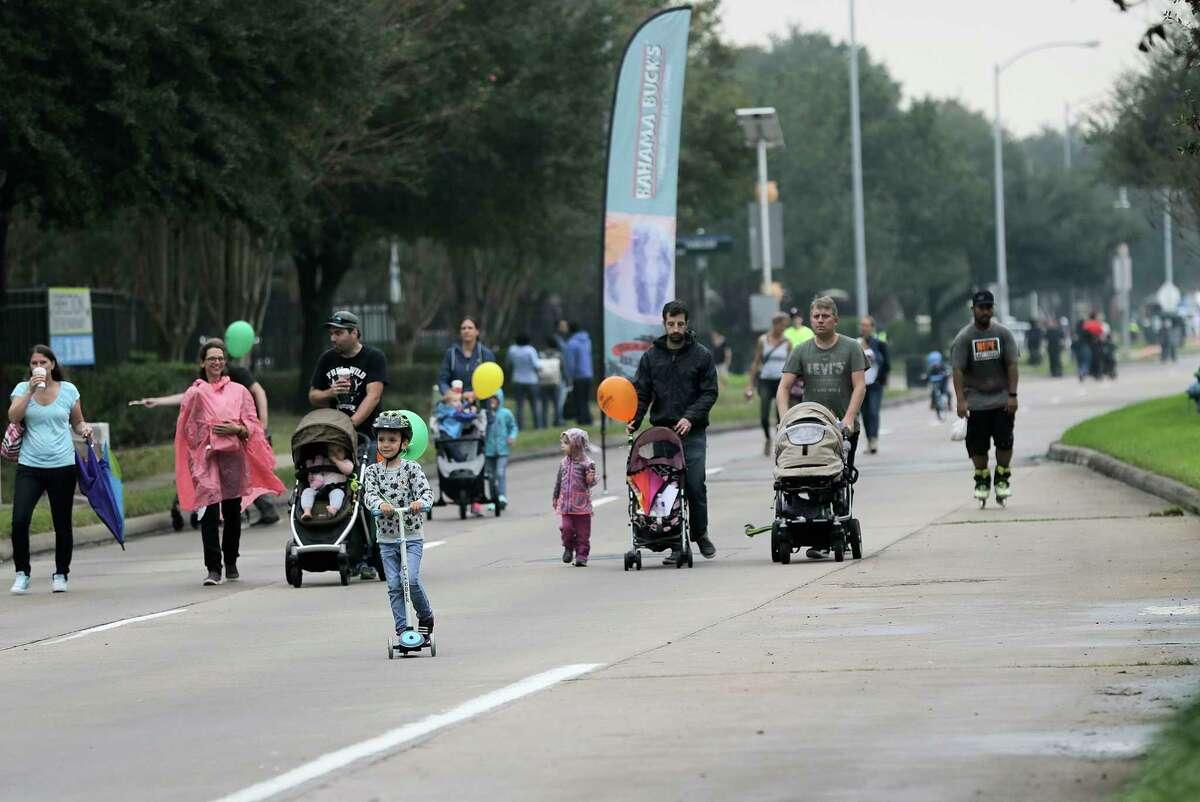 Pedestrians enjoy walking down Eldridge Parkway as the last Fall 2017 Cigna Sunday Streets event on Sunday, Dec. 3, 2017, in Houston. ( Elizabeth Conley / Houston Chronicle )