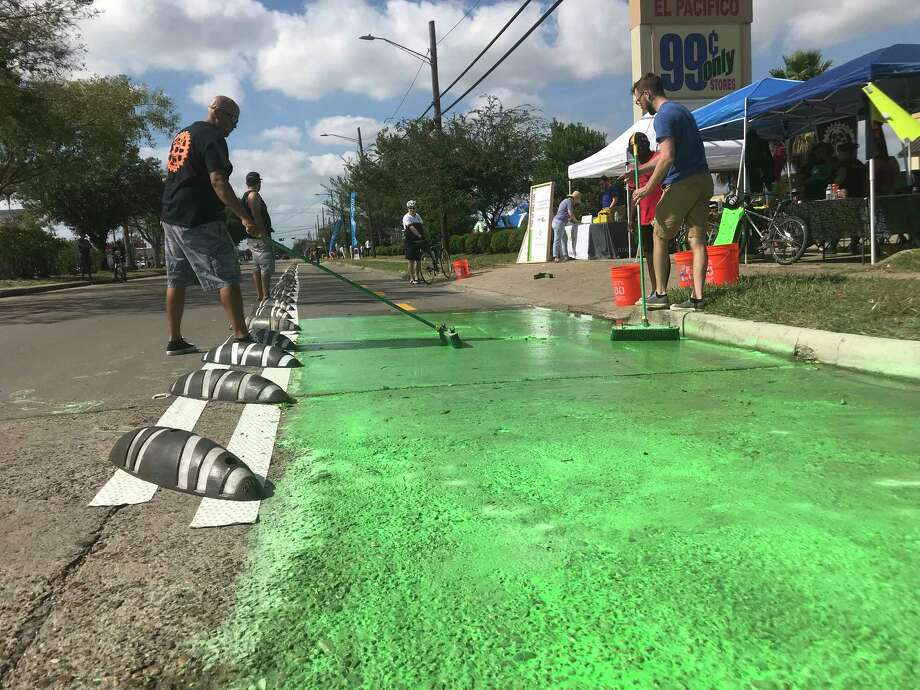 Volunteers with BikeHouston create a temporary protected bike lane during Sunday Streets in Gulfton in 2017. Photo: Dug Begley, SundayStreets1105 / Houston Chronicle