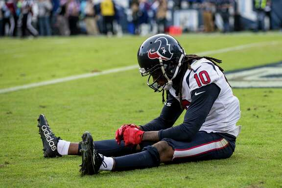 Houston Texans wide receiver DeAndre Hopkins (10) sits in the end zone after the Tom Savage pass intended for him was intercepted by Tennessee Titans cornerback LeShaun Sims during the fourth quarter of an NFL football game at Nissan Stadium on Sunday, Dec. 3, 2017, in Nashville. ( Brett Coomer / Houston Chronicle )