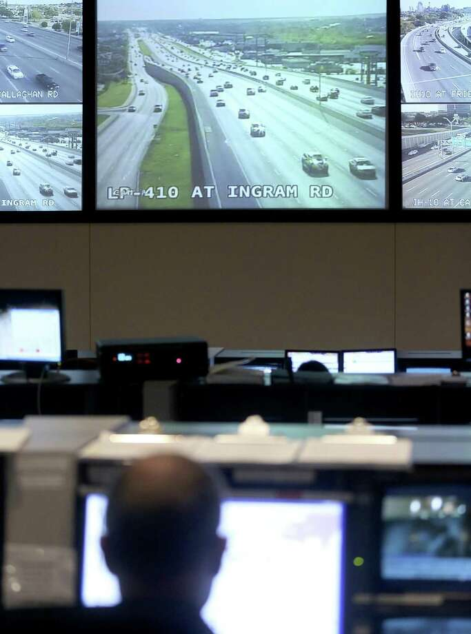 Screens display live video camera feeds Nov. 16, 2017 in the Trans-Guide control center near the intersection of Loop 410 and I-10. Photo: William Luther, Staff / San Antonio Express-News / © 2017 William Luther