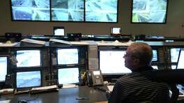 Integrated Transportation System support analyst Don Deaton works Nov. 16, 2017 in the Trans-Guide control center near the intersection of Loop 410 and I-10.