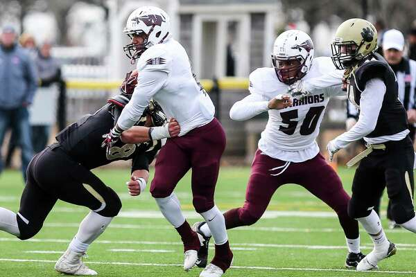 (John Vanacore/for Hearst Connecticut Media) The Hand Tigers payed host to the Windsor Warriors Sunday, December 3, 2017 at Stong Field at the Surf Club in Madison for a berth to the CIAC Class L Title game. The Tigers defeated the Warriors 31-6 to advance to the title game.