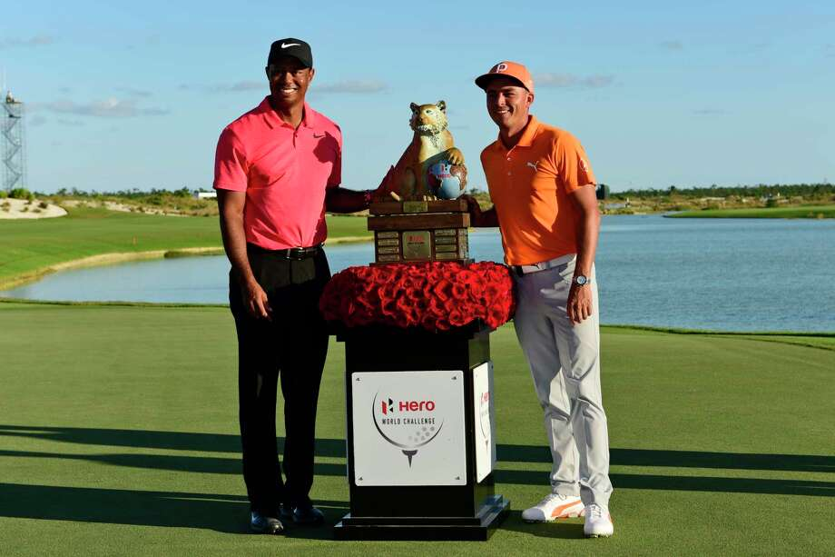 Rickie Fowler, right, poses with Tiger Woods and the trophy after Fowler won the Hero World Challenge golf tournament at Albany Golf Club in Nassau, Bahamas, Sunday, Dec. 3, 2017. (AP Photo/Dante Carrer) Photo: Dante Carrer, STR / Copyright 2017 The Associated Press. All rights reserved.