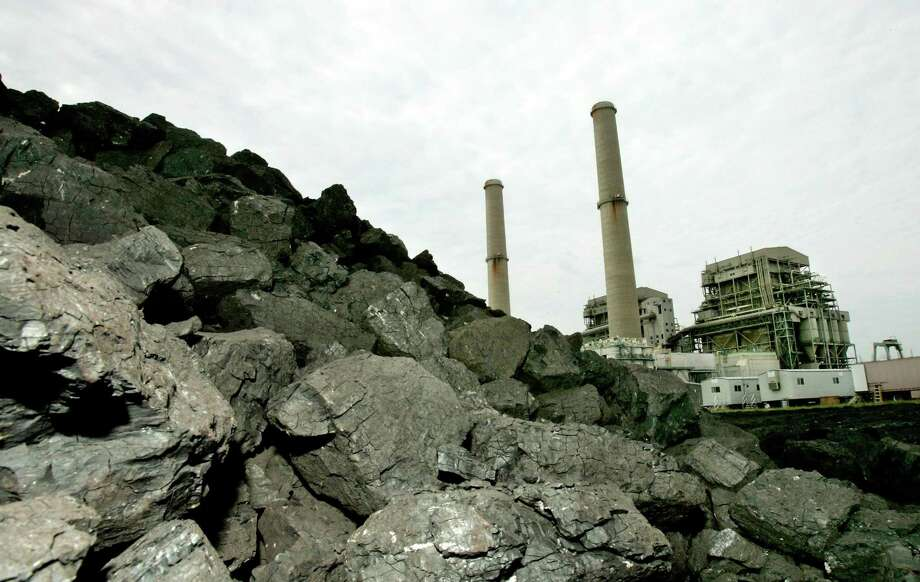 A pile of coal is shown at the TXU Corp's Big Brown power plant in this Aug. 24, 2006 file photo near Fairfield, Texas. Luminant has said it is closing its three coal-fired plants. Photo: David J. Phillip /AP / AP