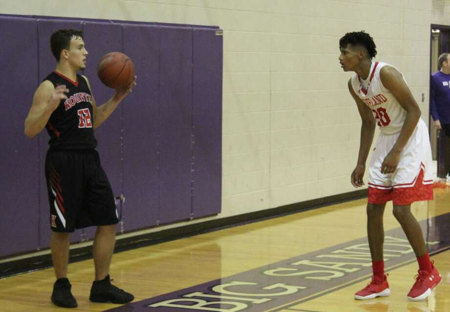 Cleveland Indian Chance Brown (right) moves in to block off a Kountze Lion (left) during the Nov. 30 basketball game at the Big Sandy Basketball Tournament. Photo: Jacob McAdams