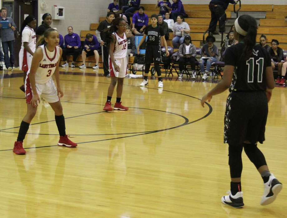 Lady Trojans Destiny Thompson (3) and Marissa Fletcher (22) stare down an incoming Franklin Lady Lion during the Dec.1 day of the Big Sandy Basketball Tournament. Photo: Jacob McAdams