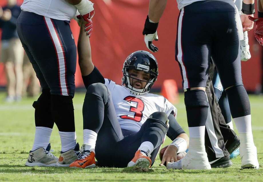 Houston Texans quarterback Tom Savage (3) is helped up after being sacked in the first half of an NFL football game against the Tennessee Titans Sunday, Dec. 3, 2017, in Nashville, Tenn. (AP Photo/James Kenney) Photo: James Kenney, FRE / FR171271 AP