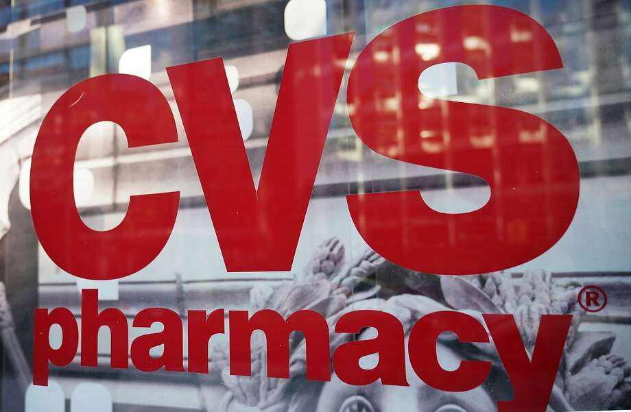 The CVS logo is seen infront of one of its stores in Washington, DC on December 3, 2017. US pharmacy chain CVS has agreed to buy medical insurer Aetna for around $69 billion, according to reports. / AFP PHOTO / MANDEL NGANMANDEL NGAN/AFP/Getty Images Photo: MANDEL NGAN, AFP/Getty Images
