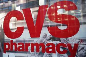 The CVS logo is seen infront of one of its stores in Washington, DC on December 3, 2017. US pharmacy chain CVS has agreed to buy medical insurer Aetna for around $69 billion, according to reports. / AFP PHOTO / MANDEL NGANMANDEL NGAN/AFP/Getty Images