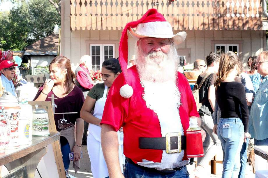 Beethoven Maennerchor was brimming with holiday spirit as Santa Claus, lederhosen and arts and crafts vendors filled the Garten for Kristkindlmarkt on Saturday, Dec. 2, 2017. Photo: Jason Gaines