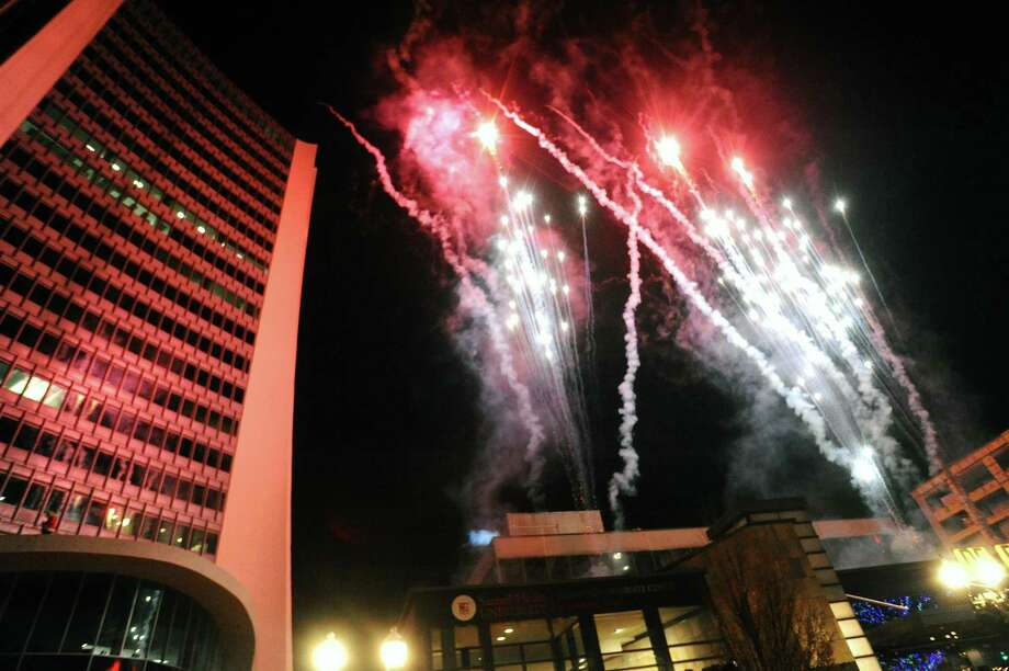 Fireworks explode over downtown Stamford, Conn. following the annual Heights & Lights event on Sunday, Dec. 3, 2017. Photo: Michael Cummo / Hearst Connecticut Media / Stamford Advocate