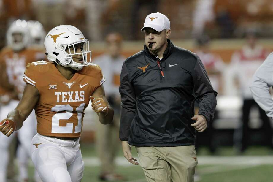 AUSTIN, TX - NOVEMBER 24:  Head coach Tom Herman of the Texas Longhorns  watches players warm up before the game against the Texas Tech Red Raiders at Darrell K Royal-Texas Memorial Stadium on November 24, 2017 in Austin, Texas.  (Photo by Tim Warner/Getty Images) Photo: Tim Warner, Stringer / Getty Images / 2017 Getty Images
