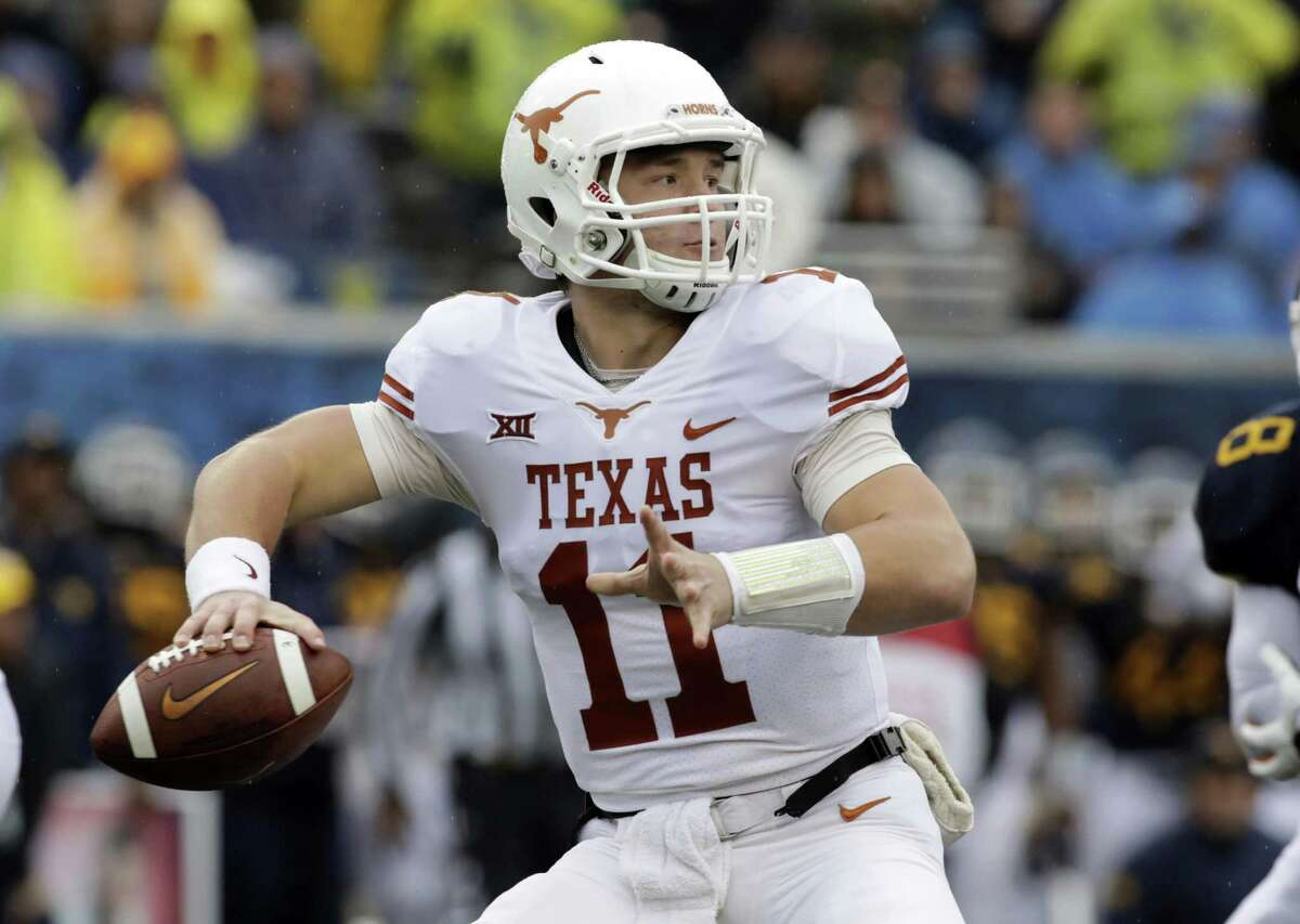 FILE - In this Saturday, Nov. 18, 2017, file photo, Texas quarterback Sam Ehlinger (11) throws a pass during the first half of an NCAA college football game against West Virginia in Morgantown, W.Va. Texas coach Tom Herman announced Monday that Sam Ehlinger will start against Texas Tech after he led the Longhorns to a 28-14 win at West Virginia in relief of Shane Buechele. (AP Photo/Raymond Thompson, File)