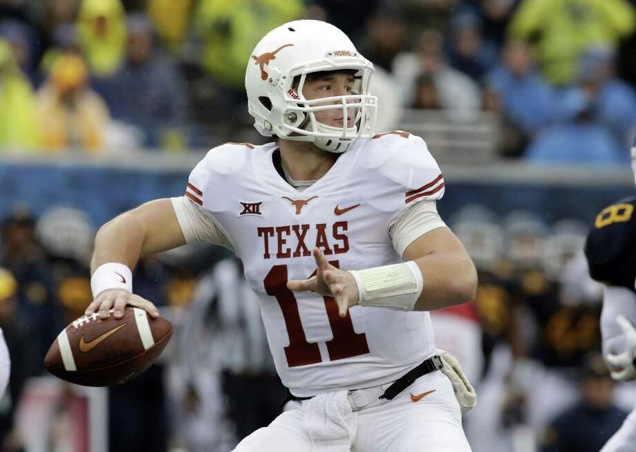 FILE - In this Saturday, Nov. 18, 2017, file photo, Texas quarterback Sam Ehlinger (11) throws a pass during the first half of an NCAA college football game against West Virginia in Morgantown, W.Va. Texas coach Tom Herman announced Monday that Sam Ehlinger will start against Texas Tech after he led the Longhorns to a 28-14 win at West Virginia in relief of Shane Buechele.  (AP Photo/Raymond Thompson, File) Photo: Ray Thompson, FRE / Associated Press / FR171247 AP