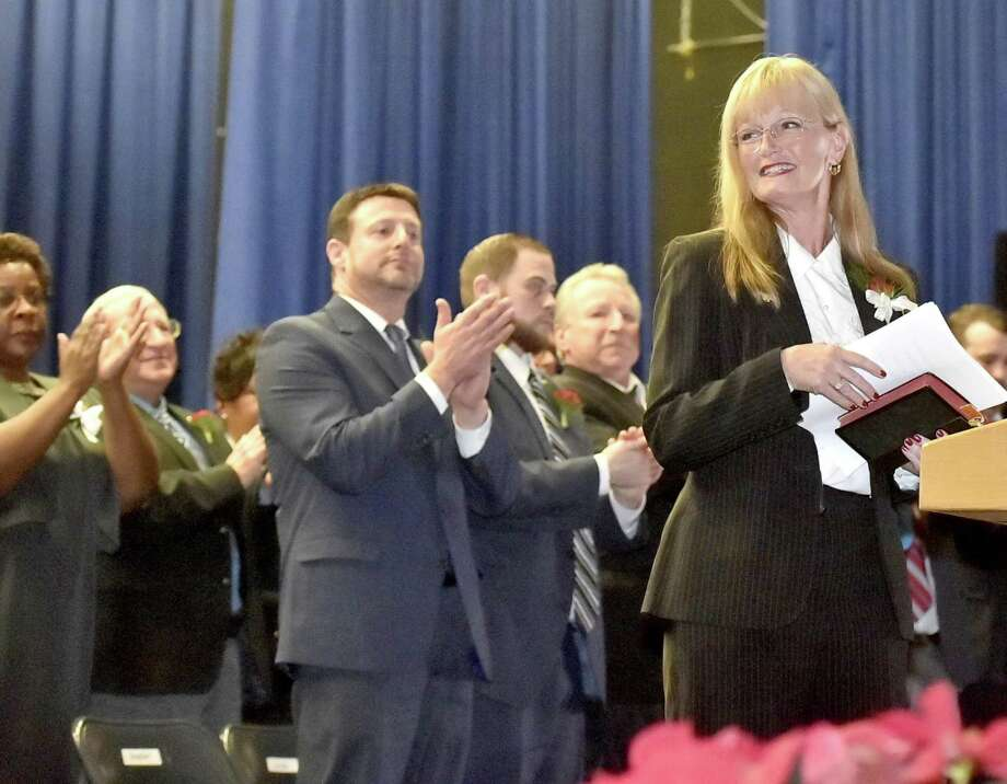West Haven Mayor Nancy Rossi is applauded after giving her inaugural address as the first woman mayor of West Haven during the City of West Haven Inaugural ceremonies Sunday afternoon at West Haven High School. Photo: Peter Hvizdak / Hearst Connecticut Media / New Haven Register