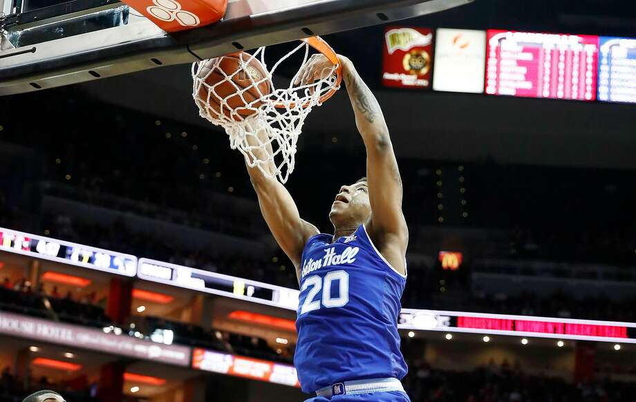 Seton Hall's Desi Rodriguez dunks against Louisville on his way to 29 points in the Pirates' upset win. Photo: Andy Lyons, Getty Images