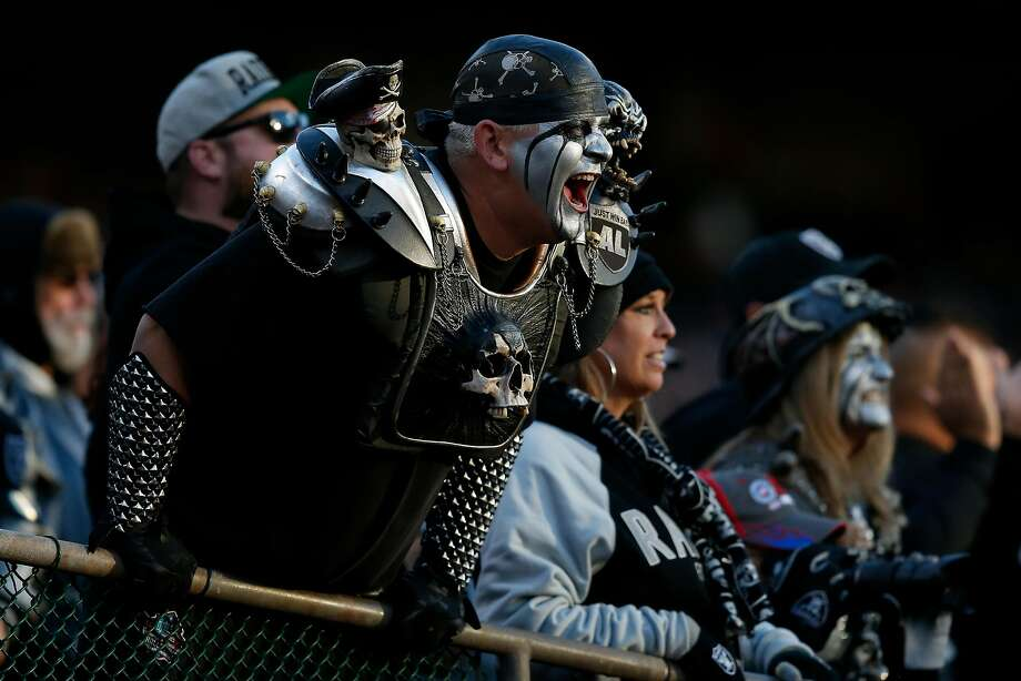 OAKLAND, CA - DECEMBER 03:  A Oakland Raiders fan cheers in the stands during their NFL game against the New York Giants at Oakland-Alameda County Coliseum on December 3, 2017 in Oakland, California.  (Photo by Lachlan Cunningham/Getty Images) Photo: Lachlan Cunningham, Getty Images