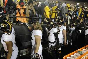 Missouri players celebrate with fans after beating Vanderbilt in an NCAA college football game Saturday, Nov. 18, 2017, in Nashville, Tenn. Missouri won 45-17. (AP Photo/Mark Humphrey)