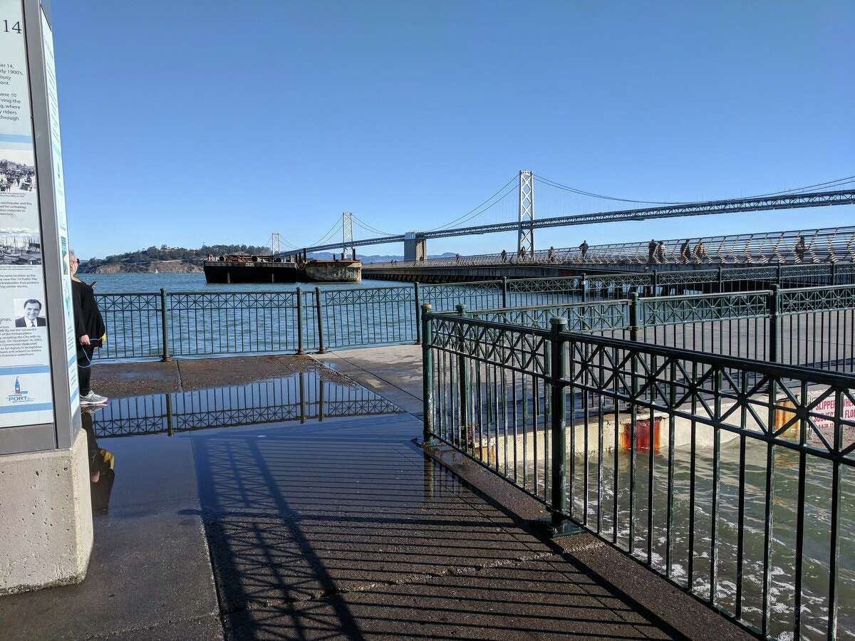 Water splashed onto the Embarcadero waterfront, south of the Ferry Building as King Tides hit the Bay Area Sunday morning.