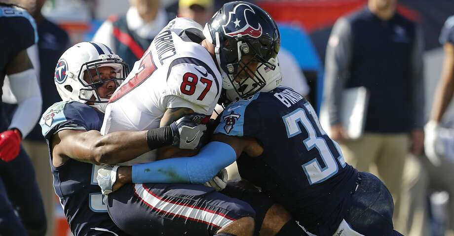 Houston Texans tight end C.J. Fiedorowicz (87) is stopped by Tennessee Titans free safety Kevin Byard (31) and inside linebacker Avery Williamson (54) during the second quarter of an NFL football game at Nissan Stadium on Sunday, Dec. 3, 2017, in Nashville. ( Brett Coomer / Houston Chronicle ) Photo: Brett Coomer/Houston Chronicle