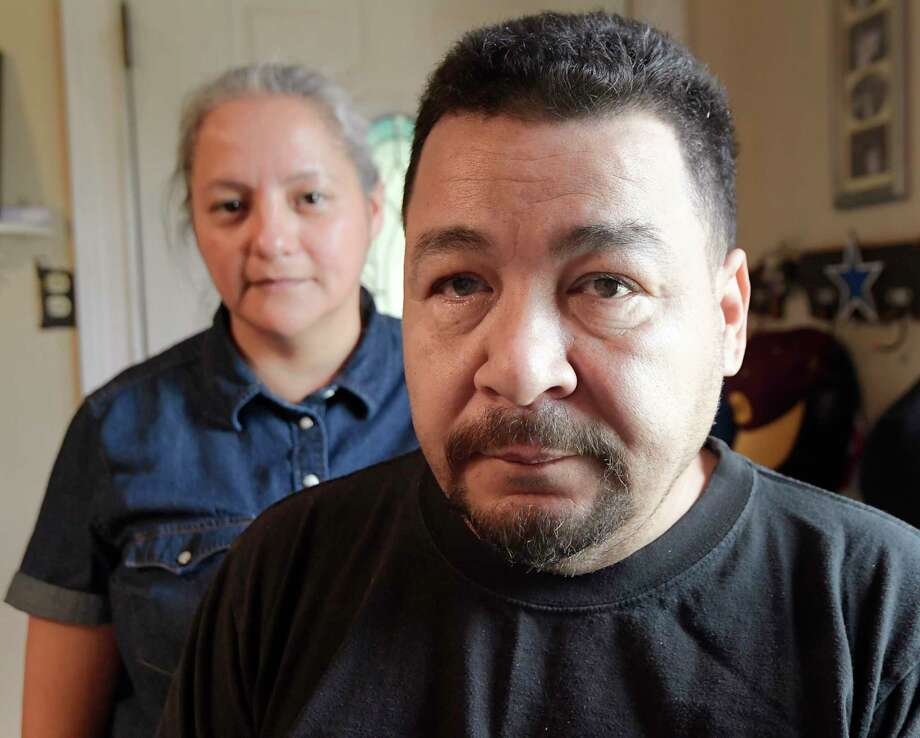 John Tovar and his wife, Mina, at home in Arlington, Texas, on November 9, 2017. John Tovar is in his mid-50s and suffers from diabetes, nerve damage in his feet, carpal tunnel and depression. His conditions forced him to stop working at his manufacturing job in 2012. He reluctantly applied for disability benefits after selling off his 401k and paying off credit card debts and most of their mortgage. But a nationwide backlog leaves him in limbo, waiting for a hearing to be told if he will be granted benefits. He was told his wait will be 12 to 18 months. (Max Faulkner/Fort Worth Star-Telegram/TNS) Photo: Max Faulkner, MBR / Fort Worth Star-Telegram