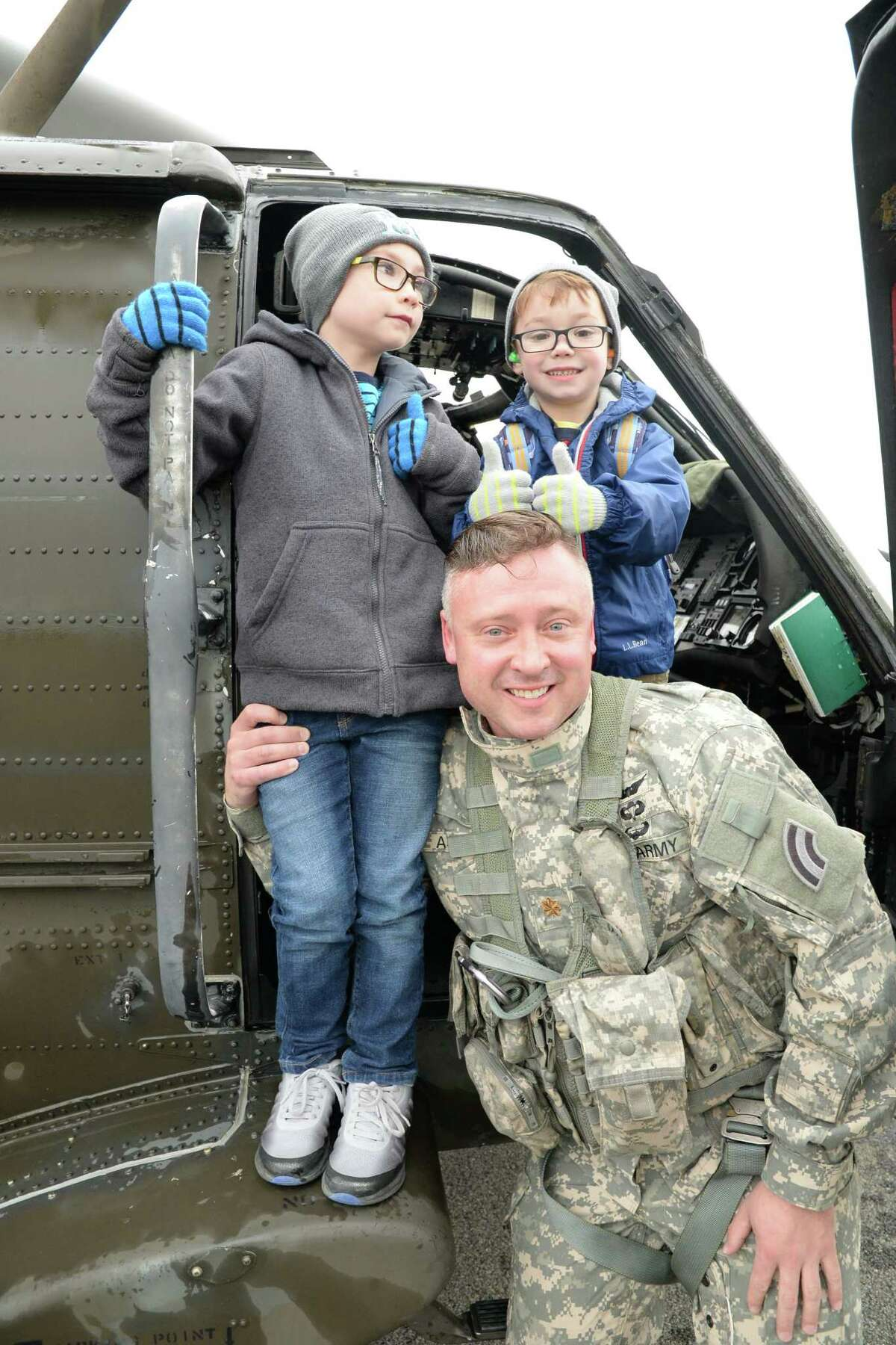 Capt. Jean Kratzer / New York Army National Guard New York Army National Guard, Maj. Michael Audette, reunites with his sons Gabriel and Samuel following Audette? s traditional military ?final flight? at the Army Aviation Support Facility in Latham.
