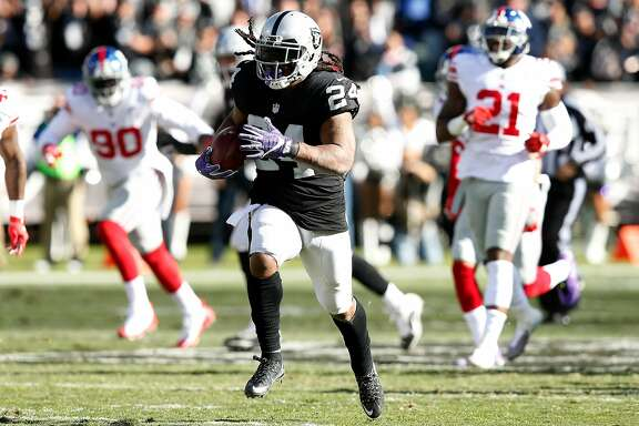 OAKLAND, CA - DECEMBER 03:  Marshawn Lynch #24 of the Oakland Raiders runs for a 51-yard touchdown against the New York Giants during their NFL game at Oakland-Alameda County Coliseum on December 3, 2017 in Oakland, California.  (Photo by Lachlan Cunningham/Getty Images)