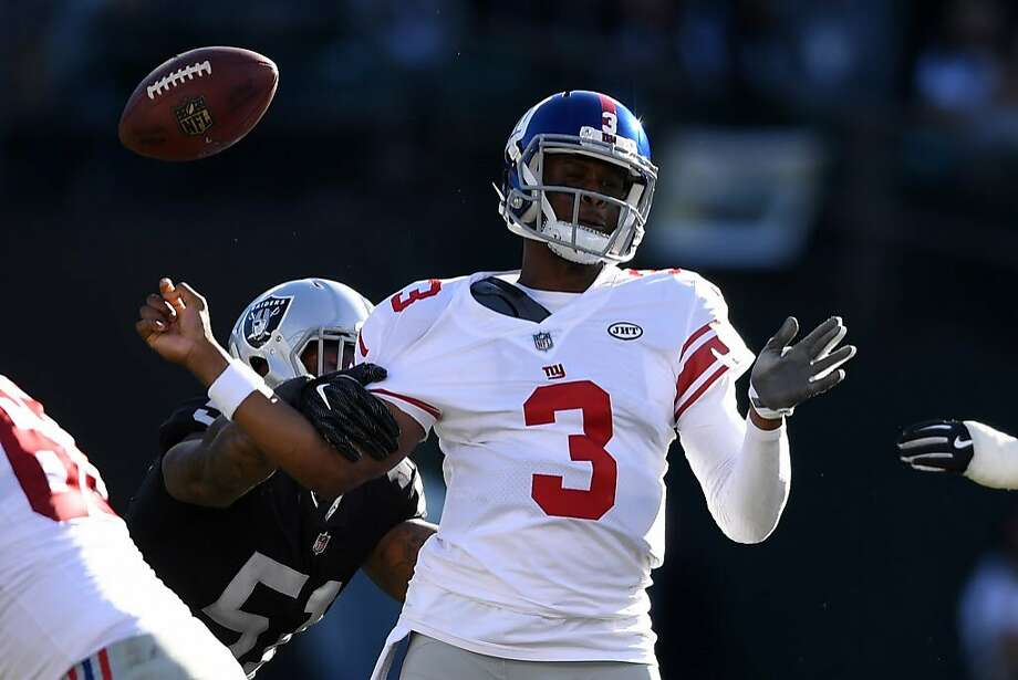 Giants quarterback Geno Smith #3 is stripped of the ball by Raiders linebacker Bruce Irvin. Photo: Thearon W. Henderson, Getty Images