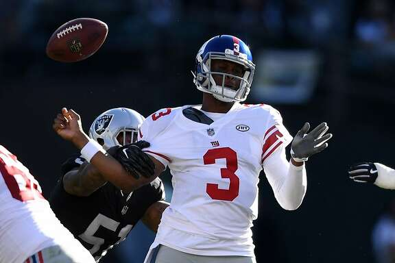 OAKLAND, CA - DECEMBER 03:  Geno Smith #3 of the New York Giants is stripped of the ball by Bruce Irvin #51 of the Oakland Raiders during their NFL game at Oakland-Alameda County Coliseum on December 3, 2017 in Oakland, California.  (Photo by Thearon W. Henderson/Getty Images)