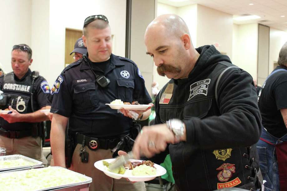 The Conroe-based Veterans of Foreign Wars Post 4709 teamed up Sunday with The        Marine Corps Reserve Toys for Tots to host a barbecue at the North        Montgomery County Community Center in Willis, which was sponsored by the        Montgomery County Precinct One Constable Philip Cash and Precinct One        Commissioner Mike Meador. Photo: Meagan Ellsworth