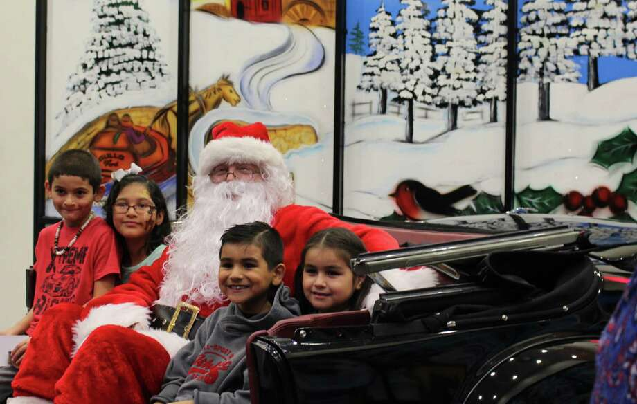 Diego,6, Clarissa, 9, Frankie, 6 and Leilani, 6, pose for a picture with Santa Claus at the Gullo Christmas for Kids Sunday, Dec. 3 inside Gullo Ford. Photo: Michelle Iracheta