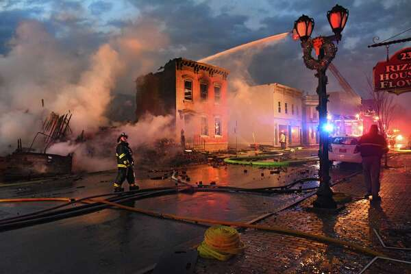 Firefighters from around the region work to control a multi-structure fire on Remsen Street on Thursday, Nov. 30, 2017 in Cohoes, N.Y. (Lori Van Buren / Times Union)