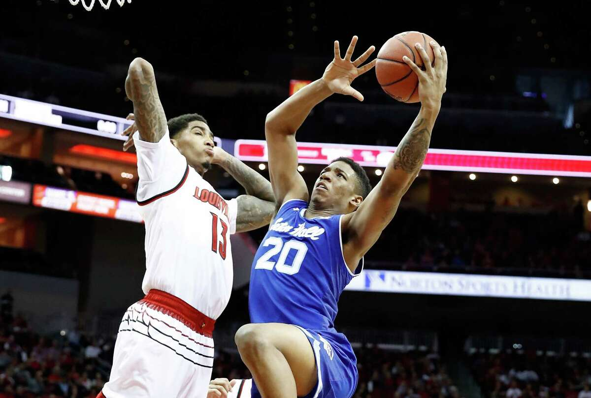 LOUISVILLE, KY - DECEMBER 03: Desi Rodriguez #20 of the Seton Hall Pirates shoots the ball against the Louisville Cardinals in the game at KFC YUM! Center on December 3, 2017 in Louisville, Kentucky. (Photo by Andy Lyons/Getty Images) ORG XMIT: 775058306