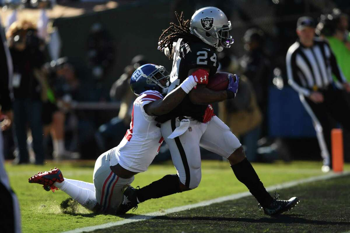 OAKLAND, CA - DECEMBER 03: Marshawn Lynch #24 of the Oakland Raiders scores on a 51-yard run against the New York Giants during their NFL game at Oakland-Alameda County Coliseum on December 3, 2017 in Oakland, California. (Photo by Thearon W. Henderson/Getty Images) ORG XMIT: 700070785