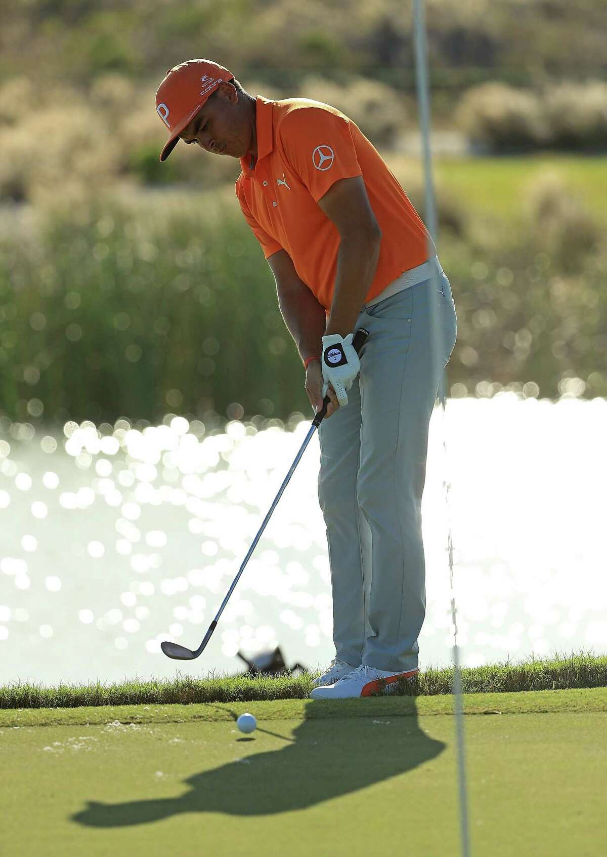 NASSAU, BAHAMAS - DECEMBER 03: Rickie Fowler of the United States chips on the 17th hole during the final round of the Hero World Challenge at Albany, Bahamas on December 3, 2017 in Nassau, Bahamas. (Photo by Mike Ehrmann/Getty Images) ORG XMIT: 775055561