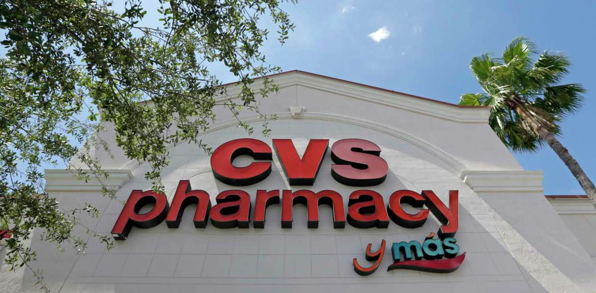 FILE - This May 15, 2017, file photo, shows a CVS pharmacy sign at a store in Hialeah, Fla. CVS will buy insurance giant Aetna in a roughly $69 billion deal that will help the drugstore chain provide more health care and keep a key client, according to a person with knowledge of the matter. (AP Photo/Alan Diaz, File) ORG XMIT: NYAG709