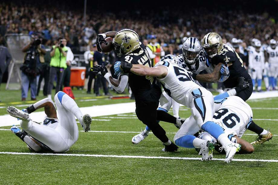 NEW ORLEANS, LA - DECEMBER 03: Alvin Kamara #41 of the New Orleans Saints scores a touchdown as Luke Kuechly #59 of the Carolina Panthers defends during the first half of a game at the Mercedes-Benz Superdome on December 3, 2017 in New Orleans, Louisiana.  (Photo by Jonathan Bachman/Getty Images) ORG XMIT: 700070773 Photo: Jonathan Bachman / 2017 Getty Images