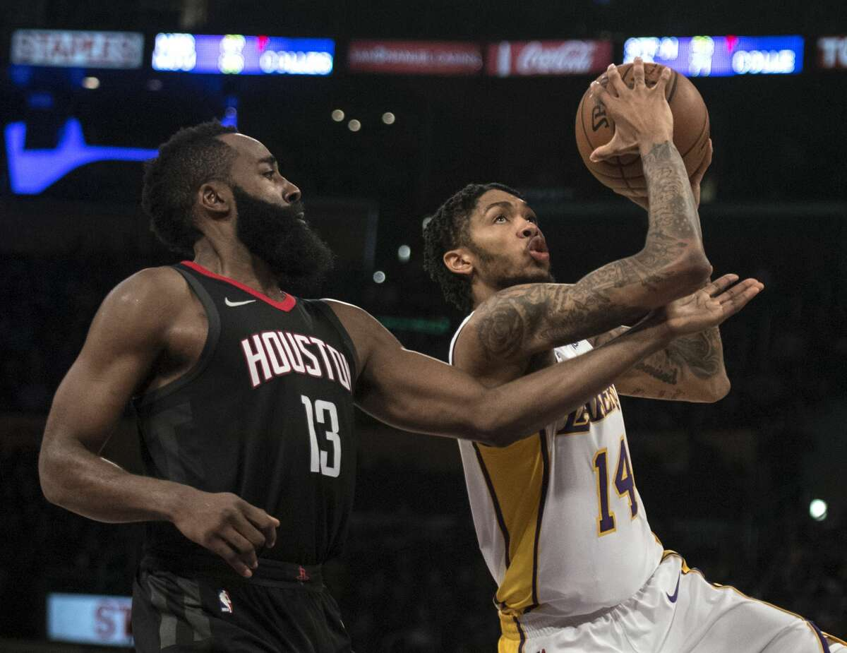 Los Angeles Lakers forward Brandon Ingram (14) goes up for a basket as Houston Rockets guard James Harden (13) defends him during the second half of an NBA basketball game Sunday, Dec. 3, 2017, in Los Angeles. (AP Photo/Kyusung Gong)