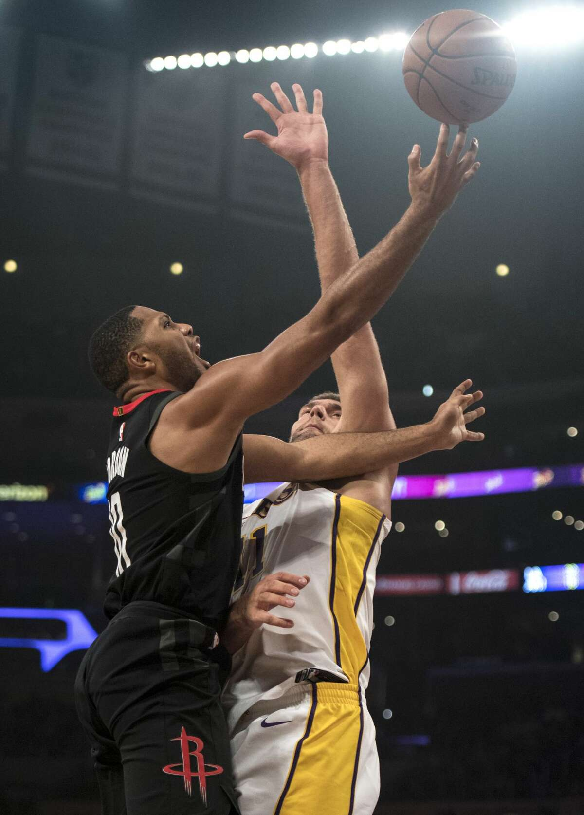 Houston Rockets guard Eric Gordon, left, shoots as Los Angeles Lakers center Brook Lopez (11) defends during the first half of an NBA basketball game Sunday, Dec. 3, 2017, in Los Angeles. (AP Photo/Kyusung Gong)